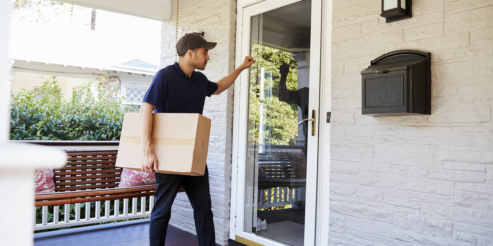 man with box home delivery