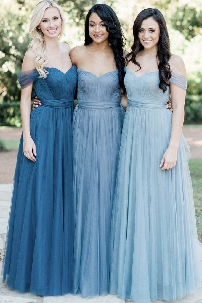 Three women showing off Revelry's bridesmaid dress selection