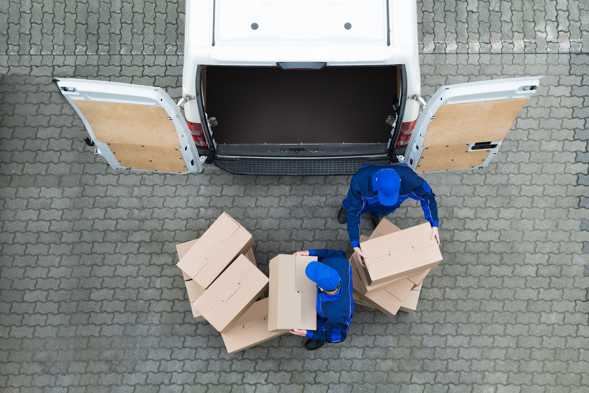 Man unloading truck of packages after visiting multiple warehouses