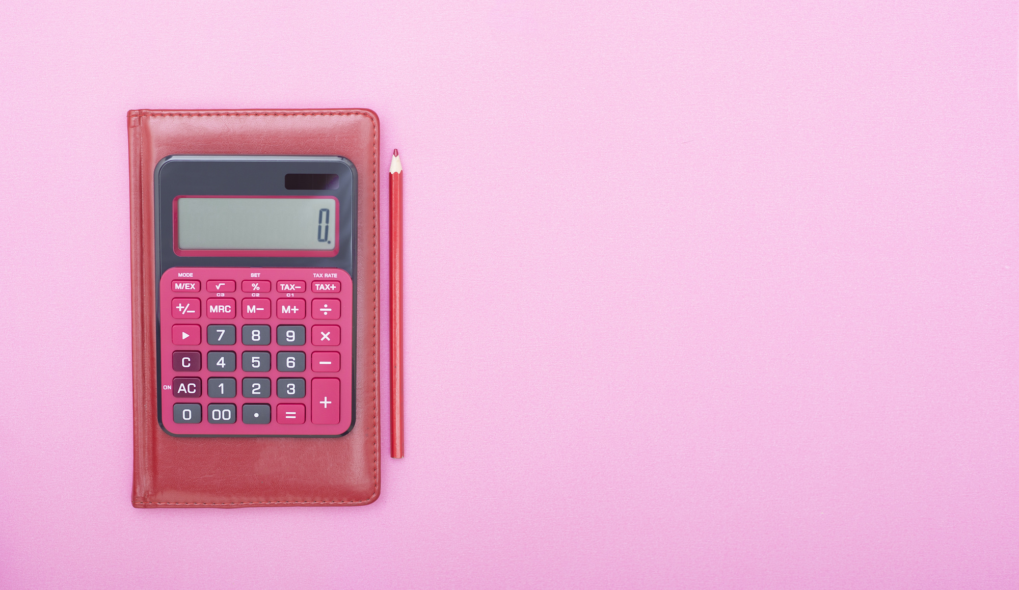 calculator on a pink background