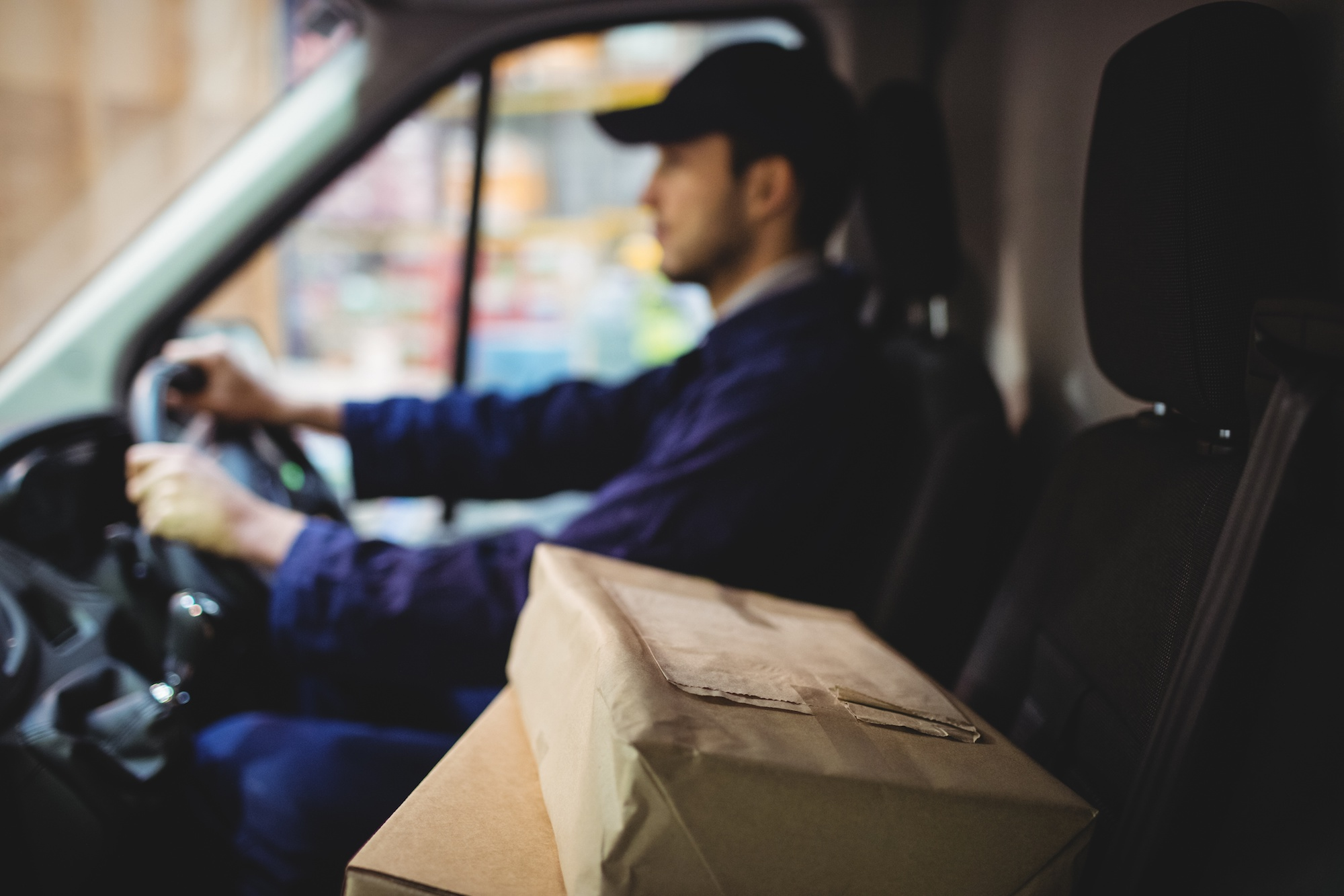 man in truck doing local delivery to a customer