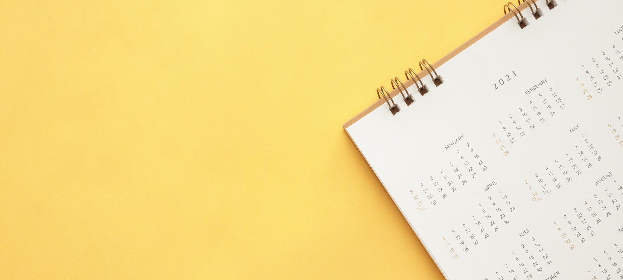2021 calendar over a yellow background